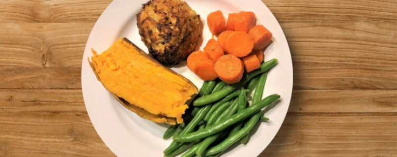 Crab Cake with half of a sweet potato, green beans, and carrots